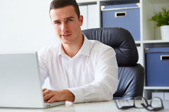 Young businessman working with laptop Royalty Free Stock Photography