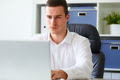 Young businessman working with laptop Royalty Free Stock Image