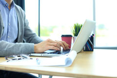 Young businessman working with laptop at office. Royalty Free Stock Image
