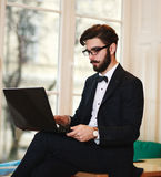 Young businessman working at a laptop in office Stock Photo