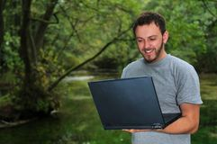 Young businessman working on laptop outdoor stock photography