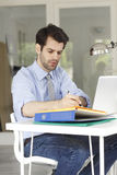 Young businessman working on laptop Stock Image