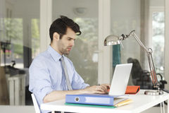 Young businessman working on laptop Royalty Free Stock Image