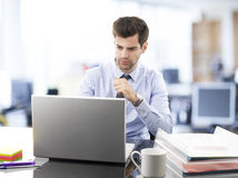 Young businessman working on laptop Royalty Free Stock Images