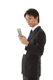 Young businessman working with mobile phone Stock Image