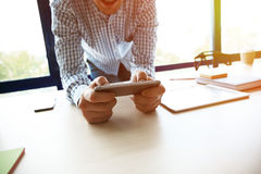 Young businessman working with modern devices, digital tablet computer and mobile phone Royalty Free Stock Photos