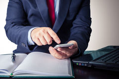 Young businessman working with modern devices, smartphone and la Royalty Free Stock Photography