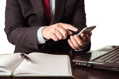 Young businessman working with modern devices, smartphone and la Stock Photography