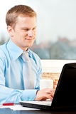 Young businessman working with notebook. Closeup of a businessman working with notebook stock photography