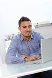 Young businessman working in office Royalty Free Stock Images