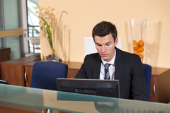 Young businessman working at office Stock Photography