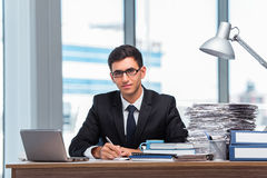 The young businessman working in the office Royalty Free Stock Image