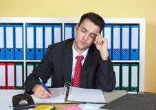 Young businessman working at office Stock Photos