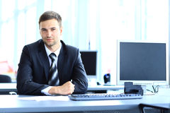 Young businessman working in office Royalty Free Stock Photography