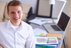 Young businessman working in office, sitting near Royalty Free Stock Image