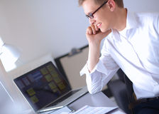 Young businessman working in office, sitting near Royalty Free Stock Photo