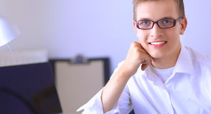 Young businessman working in office, standing near desk Royalty Free Stock Images