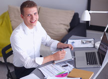 Young businessman working in office, standing near Stock Photos