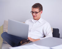 Young businessman working in office, standing near Stock Photo