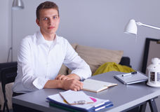 Young businessman working in office, standing near Royalty Free Stock Image