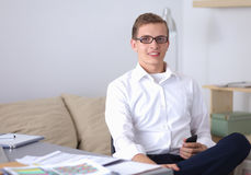 Young businessman working in office, standing near Royalty Free Stock Images