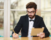 Young businessman working in office with tablet Royalty Free Stock Images