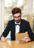 Young businessman working in office with tablet Royalty Free Stock Photo