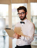 Young businessman working in office with tablet Royalty Free Stock Photography