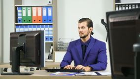 Young Businessman working in office and typing on the keyboard. Of the computer stock footage