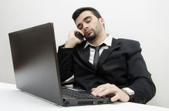 Young businessman working overtime focus on watch Royalty Free Stock Photos
