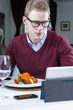 Young businessman working at a restaurant Royalty Free Stock Image