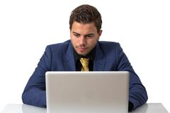 Young Businessman Working on He's Notebook Royalty Free Stock Photos