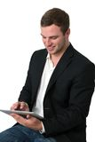 Young Businessman working on a tablet pc Royalty Free Stock Images