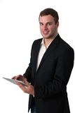Young Businessman working on a tablet pc Royalty Free Stock Photography
