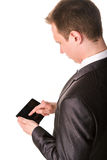 Young businessman working on a tablet pc comuter. Isolated on white Royalty Free Stock Photo