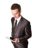 Young businessman working on a tablet pc comuter. Isolated on white Royalty Free Stock Photography