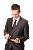 Young businessman working on a tablet pc comuter. Isolated on white Royalty Free Stock Photos