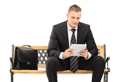 Young businessman working on a tablet Stock Photography