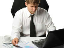 The young businessman on a workplace Stock Image