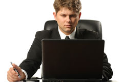 The young businessman on a workplace Royalty Free Stock Images