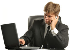 The young businessman on a workplace Stock Photography