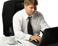 The young businessman on a workplace Royalty Free Stock Image