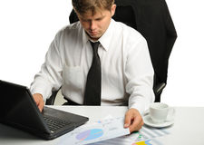 The young businessman on a workplace Royalty Free Stock Photo