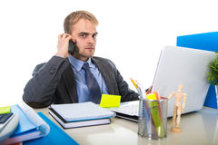 Young businessman worried tired talking on mobile phone in office suffering stress royalty free stock image