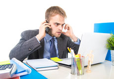 Young businessman worried tired talking on mobile phone in office suffering stress Stock Photos