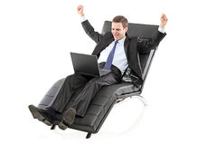 A young businessman wotrking on a laptop Royalty Free Stock Photos