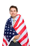 Young businessman wrapped in american flag Stock Photo