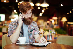 Young Businessman Wrapped up in Work Royalty Free Stock Photo