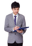 Young businessman write on clipboard Stock Photography