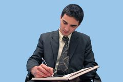 Young businessman writing Stock Image
